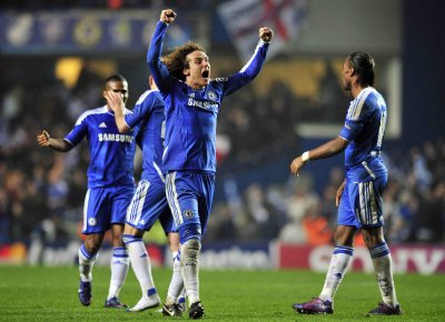Luiz celebrates at full-time